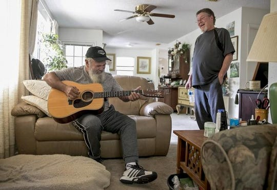Coy Featherston plays guitar in the home of his longtime friend Don Vanderburg in Lago Vista on Wednesday October 9, 2019. Featherston is a gifted artist and musician who frequently jammed with Frank Zappa, and even appeared onstage with him.