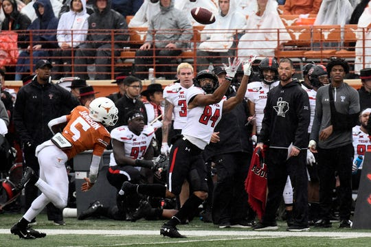 Nov 29, 2019; Austin, TX, USA; Texas Tech Red Raiders wide receiver Erik Ezukanma (84) makes a catch over Texas Longhorns defensive back D'Shawn Jamison (5) in the first half at Darrell K Royal-Texas Memorial Stadium. Mandatory Credit: Scott Wachter-USA TODAY Sports