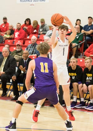 Westfall's Jay Wyman shoots a three-pointer during a 59-45 win over McClain  at the Zane Trace Tipoff Classic on Friday November 29, 2019.