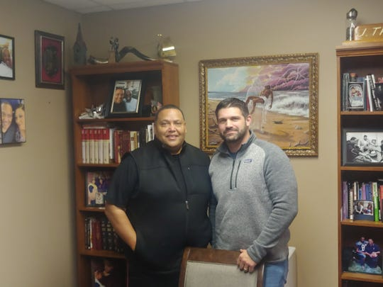 Pastor J. Troy Gray and Principal Jarod Lloyd in Gray's office Friday. The pair are among those working out the details to move Ross County Christian Academy's middle and high school into Zion Baptist Church facilities.