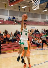 Huntington's Seth Beeler goes up for a layup during a 66-64 win over Nelsonville York at the Zane Trace Tipoff Classic on Friday November 29, 2019.