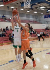 Huntington's Caleb Smith goes for a layup in a 66-64 win over Nelsonville-York at the Zane Trace Tipoff Classic on Friday November 29, 2019.
