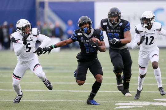 Nov 29, 2019; Memphis, TN, USA; Memphis Tigers running back Kenneth Gainwell (19) rushes in the first quarter as Cincinnati Bearcats safety Darrick Forrest (5) defends at Liberty Bowl Memorial Stadium. Mandatory Credit: Nelson Chenault-USA TODAY Sports