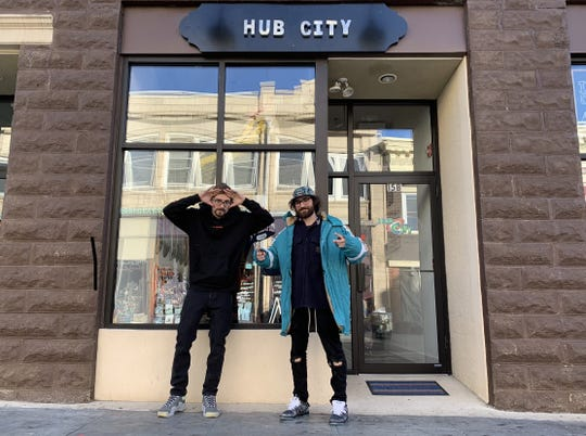 Alexander Patakos, left, and Richie Cellura in front of the store they co-own, Hub City Somerville, on Division Street.