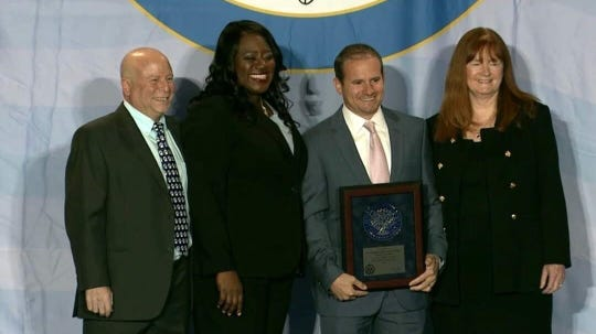 Washington School as the National Blue Ribbon Schools ceremony at National Harbor near Washington, D.C. on Nov. 15. (Left to right) Washington School principal Dr. Andrew Perry, fifth grade teacher Matthew Cognetti and Superintendent Dr. Margaret Dolan on hand to accept the award from NBRS Program Director Abba Kumi (2nd from left).  Washington School was one of nine schools in New Jersey and 312 public schools nationwide to receive the prestigious Blue Ribbon School designation for 2019.