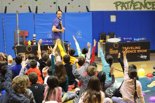 Third grade students from ALT, Central, Mt. Horeb and Woodland are photographed eagerly raising their hands to participate during the Traveling Science Show at ALT.