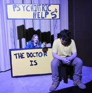 "Courtney Snyder as Lucy and Alex Hogue as Charlie Brown appear in ""A Charlie Brown Christmas"" opening at the Triple Locks Theater. Show dates are split between younger and older casts."