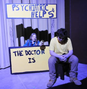 """Courtney Snyder as Lucy and Alex Hogue as Charlie Brown appear in """"A Charlie Brown Christmas"""" opening at the Triple Locks Theater. Show dates are split between younger and older casts."""