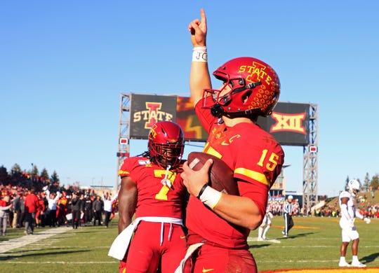Iowa State quarterback Brock Purdy, right, celebrates his touchdown with Iowa State wide receiver La'Michael Pettway, left, during the second half Iowa State's game against Kansas on Saturday, Nov. 23, 2019, in Ames, Iowa.