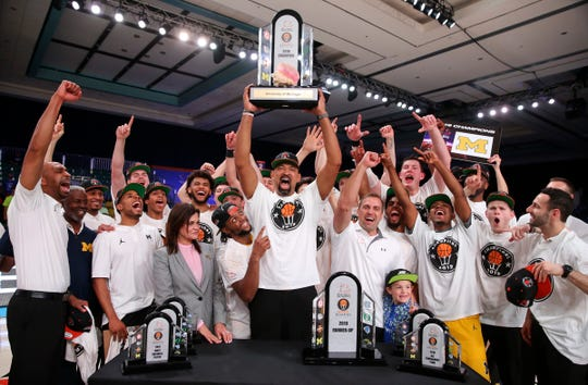Michigan coach Juwan Howard and players celebrate winning the Battle 4 Atlantis tournament after U-M's 82-64 win over Gonzaga in the Battle 4 Atlantis final in Paradise Island, Bahamas on Friday, Nov. 29, 2019.
