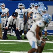 Muskegon Mona Shores coach Matt Koziak watches his team on offense during Mona Shores' 35-26 win in the Division 2 state final at Ford Field on Friday, Nov. 29, 2019.