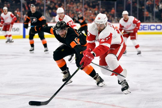 Red Wings forward Brendan Perlini, right, skates past the Flyers' Matt Niskanen during the first period.