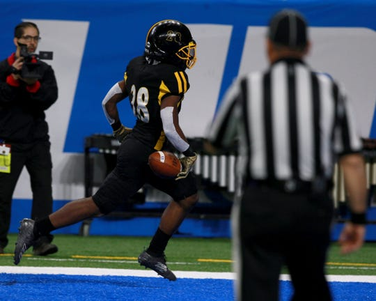 Detroit King's Justin Whyte scores a touchdown during the first half of Mona Shores' 35-26 win in the Division 2 state final at Ford Field on Friday, Nov. 29, 2019.
