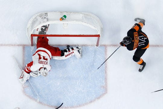 Flyers' Sean Couturier scores a goal past Red Wings goaltender Calvin Pickard during the second period Friday.