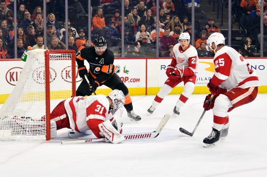 Philadelphia Flyers' Sean Couturier scores past Detroit Red Wings goaltender Calvin Pickard during the second period Friday, Nov. 29, 2019, in Philadelphia.