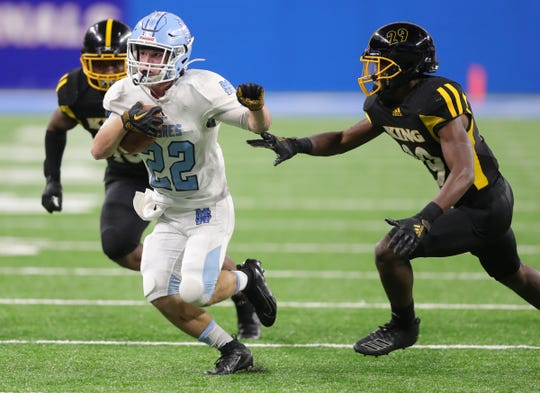 Muskegon Mona Shores' Brady Rose runs then ball against Detroit King during the first half of the Division 2 football game between Muskegon Mona Shores and Detroit King at Ford Field on Friday, Nov. 29, 2019.
