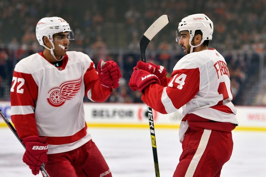Detroit Red Wings' Robby Fabbri, right, celebrates with Andreas Athanasiou after Fabbri scored during the first period against the Philadelphia Flyers, Friday, Nov. 29, 2019, in Philadelphia.