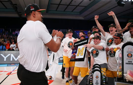 Juwan Howard and his players celebrate winning the Battle 4 Atlantis tournament after Michigan's 82-64 win over Gonzaga in Paradise Island, Bahamas on Friday, Nov. 29, 2019.