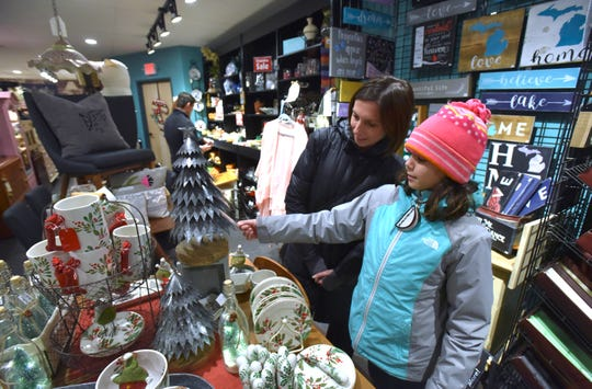 At Tootie and Tallulah's in Berkley on Black Friday,  Kim Short holiday shops with her daughter Abigail, 12, both of Berkley.