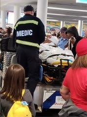 Medics attending to a woman after giving birth on the plane at at Charlotte Douglas International Airport, Wednesday in Charlotte, N.C.