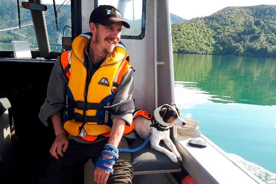 Flint, the rat-detecting dog, and his handler Richard Johnston ride a boat  in New Zealand. Flint was on a remote island between New Zealand and Antarctica when a sea lion charged at him. He got spooked and ran away. The team was forced to leave him behind on Wednesday. But he was rescued on Friday, Nov. 29 after a helicopter crew found he'd walked back to the base.