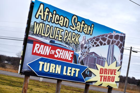 A sign directs traffic to the African Safari Wildlife Park on Friday, Nov. 29, 2019, where officials say at least 10 animals were killed Thursday in a barn fire at the wildlife park in Port Clinton, Ohio.