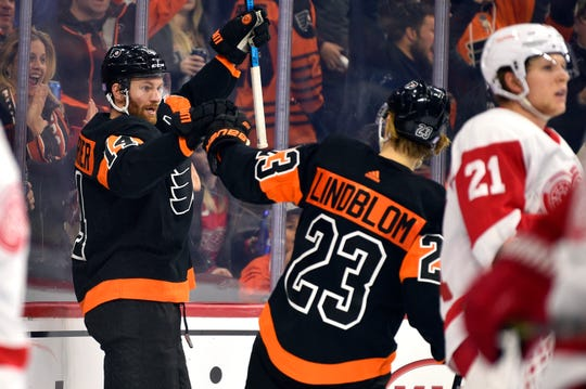 Philadelphia's Sean Couturier, left, celebrates with Oskar Lindblom after Couturier scored a goal during the second period.