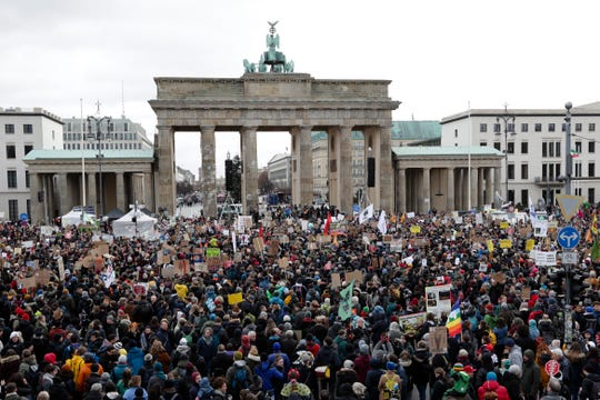 Young people attend a protest of the Fridays For Future movement in front of the Brandenburg Gate in Berlin, Germany, Friday, Nov. 29, 2019.