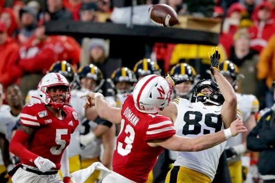 Iowa wide receiver Nico Ragaini reaches for the ball against Nebraska linebacker JoJo Domann during the second half Friday.