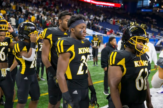 Dejected Detroit King players, including Marcus Trusel (29), stands in line to shake hands.