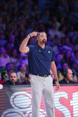 Michigan head coach Juwan Howard looks on during the game.