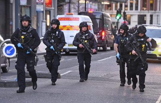Police on Cannon Street in London near the scene of an incident on London Bridge in central London following a police incident, Friday, Nov. 29, 2019.