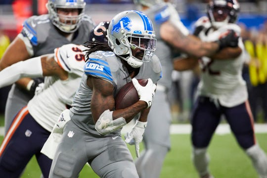 Detroit Lions running back Bo Scarbrough rushes against the Chicago Bears.