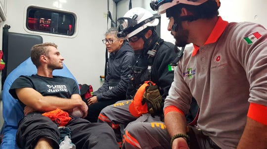 Aidan Jacobson sits inside an ambulance  after he was rescued after falling from the El Potrero Chico peak in Hidalgo, Mexico. Jacobson was climbing with California free solo climber Brad Gobright who died in the fall.