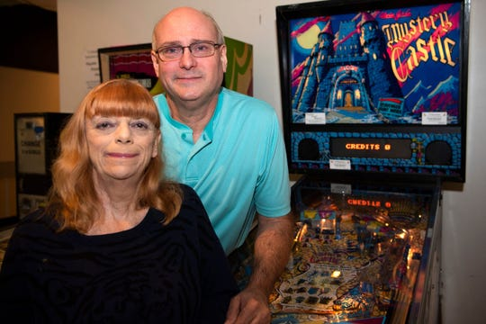 Terry and Jane Groves at the Playable Pinball Museum inside McCamly Place in Battle Creek.