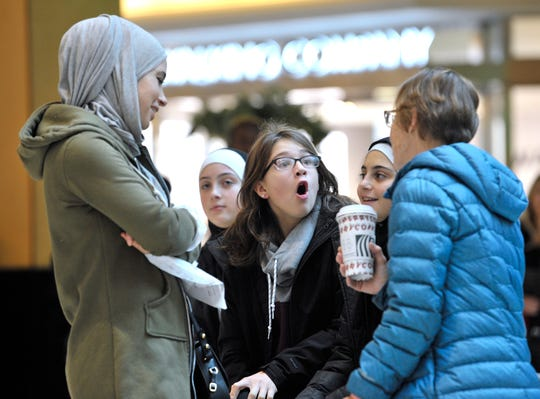From left, Stacey Stewart of Dearborn, her daughter Zahraa Zahr, 16, niece Gabby Ujkic, 12, of Almont, and daughter Soukayna Zahr, 13, talk with mother/grandmother Karlene Stewart, also of Almont, during their Black Friday shopping trip at Somerset Collection in Troy.