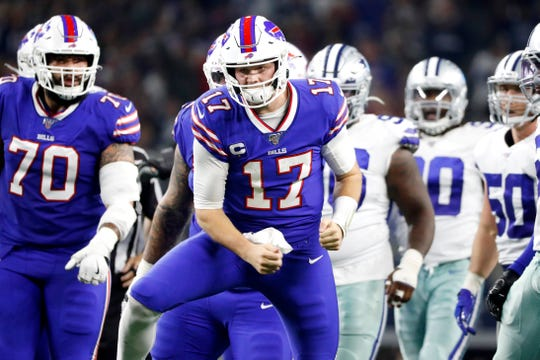 Buffalo Bills quarterback Josh Allen celebrates after a quarterback sneak to convert on fourth down during the first half of Thursday's win over the Cowboys.