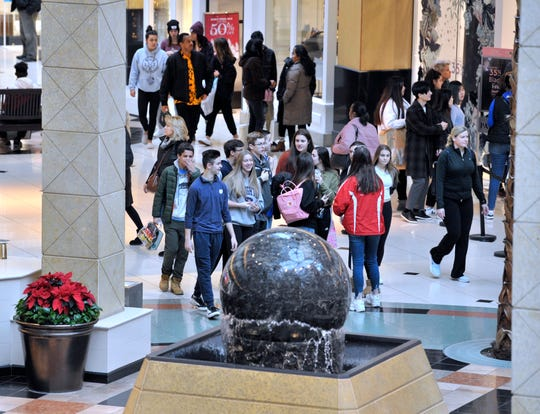 People walk through the Grand Court as they shop at Somerset Collection in Troy on Black Friday.