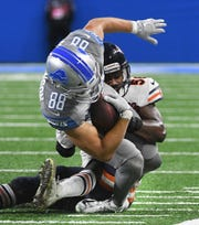 Lions rookie tight end T.J. Hockenson is taken down after a completion by Bears' Roquan Smith, bending his foot backwards late in the fourth quarter.  Hockenson was taken off the field on a cart after the game.