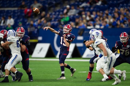 Heritage Hills' Cole Sigler (15) passes the ball during the Heritage Hills vs Bishop Chatard IHSAA State Football Game at Lucas Oil Stadium in Indianapolis, Ind., Friday, Nov. 29, 2019. Bishop Chatard won 34-3 over No. 2 Heritage Hills.