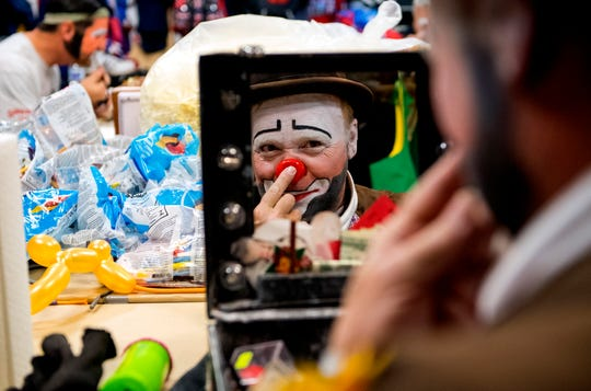 "Hadi Funsters guest clown Mike ""Squeeky"" Kapshandy of Springfield, Ill., applies pressure to secure his clown nose while he prepares for the  86th Hadi Shrine Circus at Ford Center Friday morning, Nov. 29, 2019."