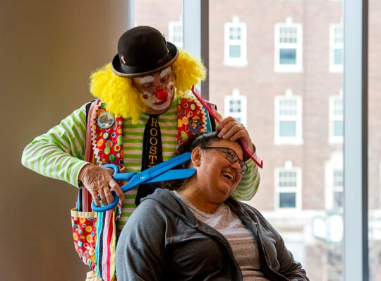"Hadi Funster Bob ""Rooster"" Brown gives a faux haircut to Shelia Claridge before the 86th Hadi Shrine Circus at Ford Center Friday morning, Nov. 29, 2019."