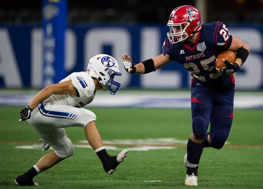 Heritage Hills' Jacob Wetzel (25) runs past Bishop Chatard's Thomas Joven (14) before getting tackled at the Heritage Hills vs Bishop Chatard IHSAA State Football Game at Lucas Oil Stadium in Indianapolis, Ind., Friday, Nov. 29, 2019. Bishop Chatard won 34-3 over No. 2 Heritage Hills.