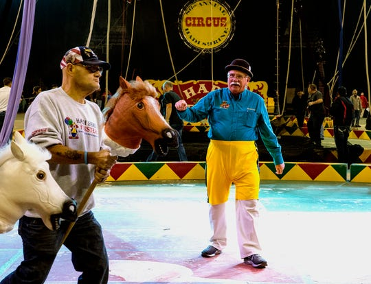 "Hadi Funster Bob ""Rooster"" Brown, right, cheers on the ""horses"" as the Funster practice their horserace skit during a dress rehearsal of the 86th Hadi Shrine Circus at Ford Center Wednesday evening, Nov. 27, 2019."