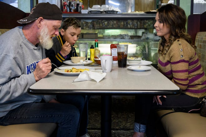 Harold Jones, front left, shares a meal with Holly Byers, right and her 12-year-old son Maddox, back left, at the Cross-Eyed Cricket in Evansville, on Thanksgiving, Thursday morning, Nov. 28, 2019. Byers wanted to treat Jones to a thanksgiving meal outside of the Evansville Rescue Mission, where he resides.