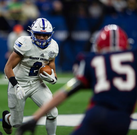 Bishop Chatard's Daylen Taylor (2) runs the ball during the Heritage Hills vs Bishop Chatard IHSAA State Football Game at Lucas Oil Stadium in Indianapolis, Ind., Friday, Nov. 29, 2019. Bishop Chatard won 34-3 over No. 2 Heritage Hills.