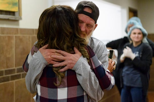 Holly Byers gives Harold Jones a hug as she arrives to the Evansville Rescue Mission to help serve food during her lunch hour, Monday afternoon, Nov. 25, 2019. Byers and Jones developed a years-long friendship after meeting at the homeless shelter, where Byers regularly volunteers and Jones resides.