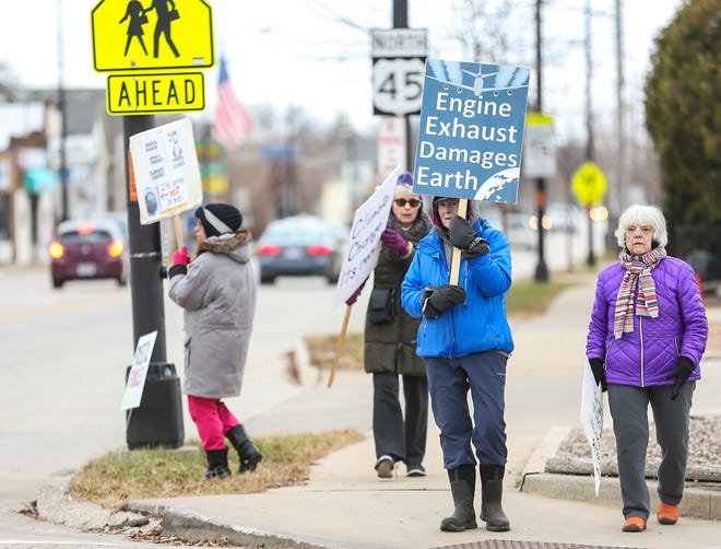 A group of people protest climate change Friday, Nov. 29, 2019 at the intersection of Main Street and Johnson Street in Fond du Lac, Wis. Pictured are, from left, Lynette Liepert, Karen Schuppe, Diana Beck and Lisette Aldrich.