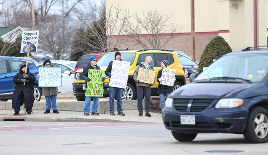 A group of people protest climate change Friday, Nov. 29, 2019 at the intersection of Main Street and Johnson Street in Fond du Lac, Wis. From left to right are Donna Innes, Mary Rose Meis, Richard Freund, Tom Schuppe, and Kurt and BJ Belzer.