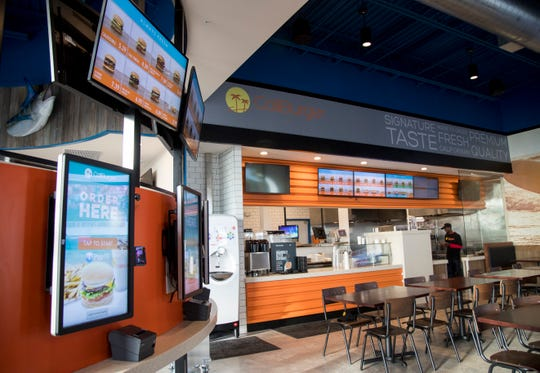 CaliBurger, which shares a space with Marlins Brewhouse in Estero, has touchscreens with facial recognition for ordering.
